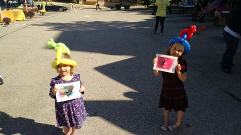 Ava and Lily at a fall festival